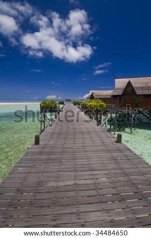 Walkway to tropical island resort - stock photo