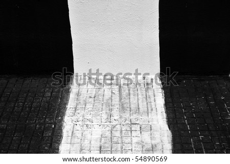 black and white urban backgrounds. stock photo : Wall and sidewalk painted black and white. Urban background.