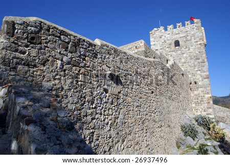 Wall and tower of St Peter's castle in Bodrum, Turkey