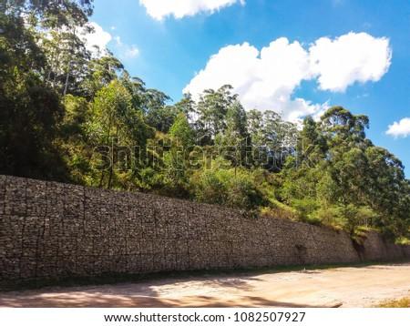 Wall and trees near Belo Horizonte, Brazil #1082507927