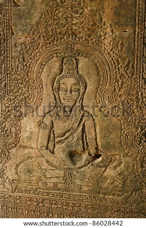 Wall art carving in Angkor Wat Cambodia South East Asia