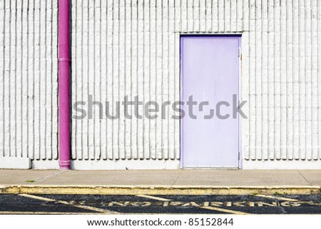 wall background with purple door, pink gutter & no parking