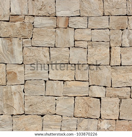 Wall beige stone structure.
