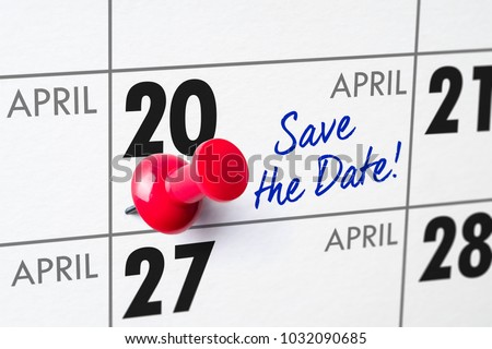 Wall calendar with a red pin - April 20 #1032090685
