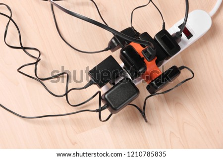 Wall chargers plugged in gang socket #1210785835
