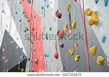 wall climbing wall, with protrusions, ropes and carbines #1027323673