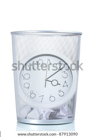 Wall Clock in metal trash bin and paper isolated on white