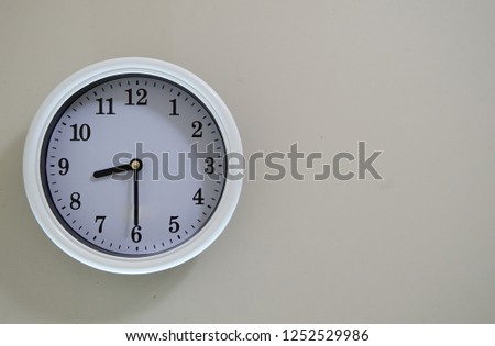 Wall clock time of the room is 8:30                                #1252529986