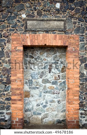 Wall clogged doors of medieval church in Sobotka, Poland. Latin inscription saying about church reneval.
