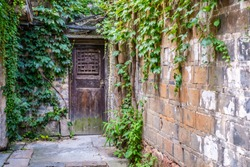 Wall covered with vines and wooden doors in Wuzhen West Gate (Xizha) Scenic Area