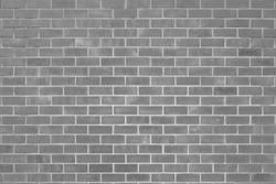 Wall dark brick wall texture background. Brickwork or stonework flooring interior rock old pattern clean concrete grid uneven bricks design stack