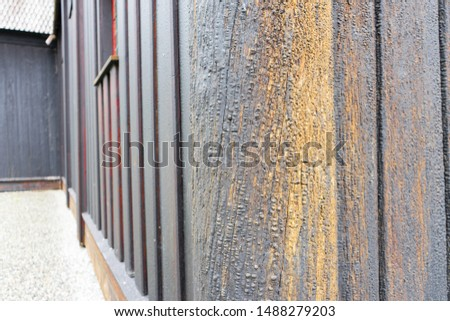 Wall detail of the stave church in Ringebu. Also called the post church and palisade church. Color peeling off, tar tears, wooden details look very old. Norway, Scandinavia,