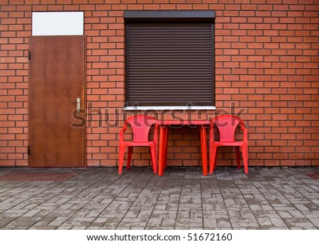 wall from a red brick, by a window, door and chairs for your illustrations