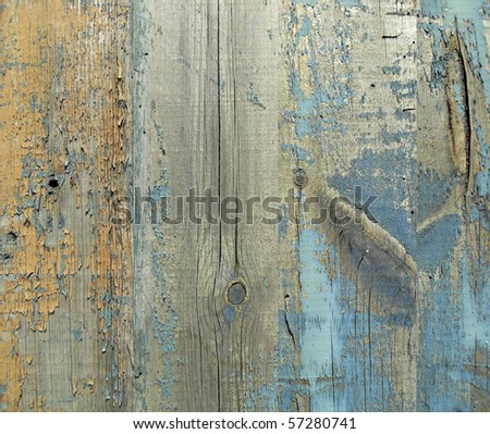 Wall from wooden planks with paint traces