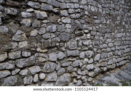 Wall in stone blocks #1105124417