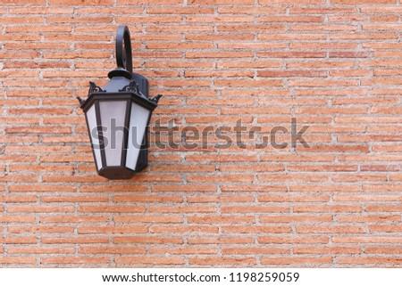 Wall lamp on brick wall background #1198259059