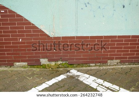 Wall made of bricks by sidewalk