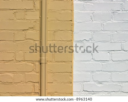 Wall made of painted yellow and white bricks