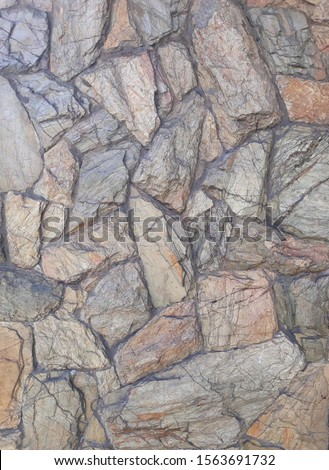 wall made with many stones of various sizes and various shapes, backdrop #1563691732