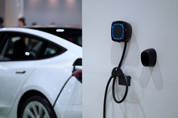Wall mounted electric charger in the home garage.