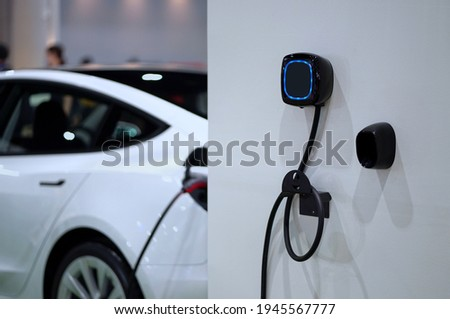 Wall mounted electric charger in the home garage. Stockfoto ©