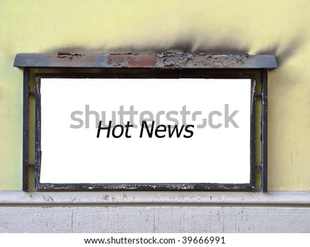 Wall-mounted rusty billboard after the fire, ragged coat of paint