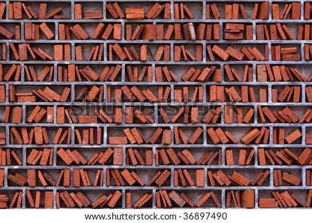 wall of a library in wimbledon, london arranged like book shelves - stock photo