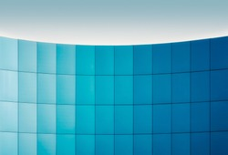 wall of a modern building with a gradation of blue architectural abstract background pattern