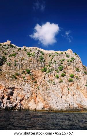 Wall of an ancient fortress at rock top. Alanya. Turkey