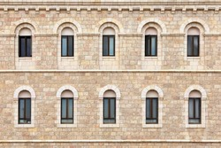 Wall of building made from Jerusalem stone with windows