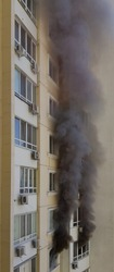 Wall of building with blurred black smoke of fire accident. Arson in protests