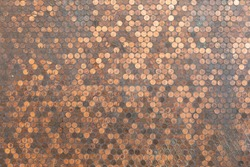Wall of copper American pennies, in a currency background