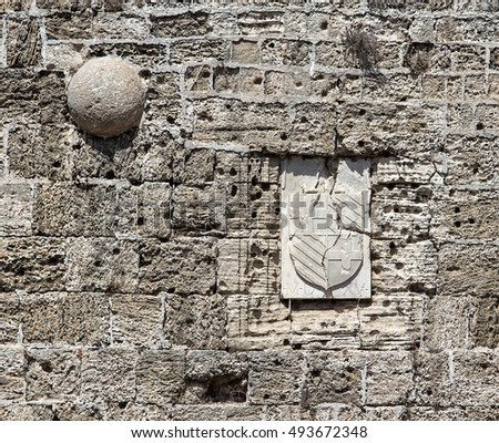https://image.shutterstock.com/display_pic_with_logo/2449808/493672348/stock-photo-wall-of-fortress-of-rhodes-castle-close-up-with-traces-from-bullets-and-shattered-arms-493672348.jpg