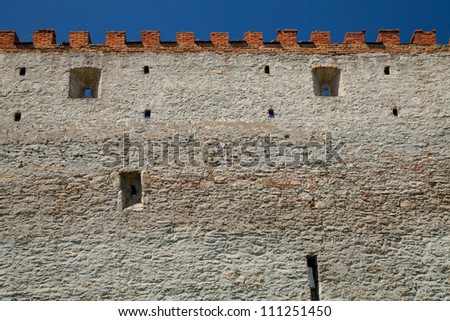 Wall of medieval castle - stock photo