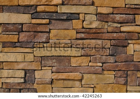 Wall of Multiple Colored Stone used as a background