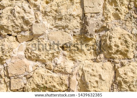 Wall of old sandstone bricks as background #1439632385