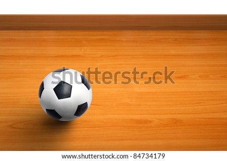 wall of room with a ball on wooden floor