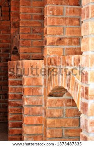 wall of rustic brick, brick applied brick, brick used in construction #1373487335