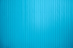 Wall of sheet metal, corrugated metal. Background. blue Corrugated metal texture surface or galvanize steel background