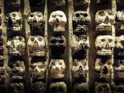 Wall of Skulls. A stone wall with skull carvings found at the Templo Mayor in Zocalo, Mexico City.