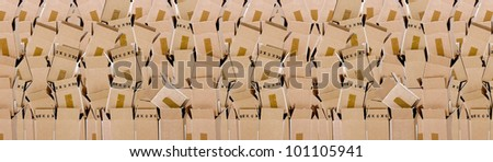 Wall of stacked brown boxes as a background