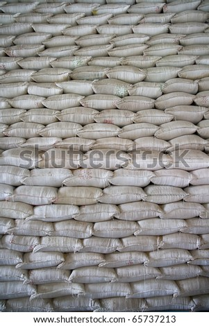 Wall of stacked rice sacks in grain factory, Vietnam