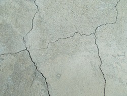 wall of the house in the cracks