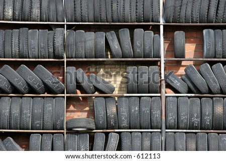 wall of used car tires