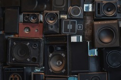 Wall of vintage loudspeakers, background. Low key filtered