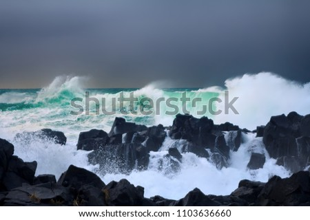 Wall of water like tsunami - turbulent waves of Pacific ocean more than 5 meters (heavy) and rugged beauty of basalt rocks