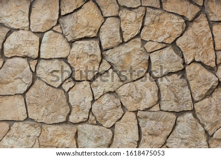Wall of wild beautiful brown brown large stone, texture, background
