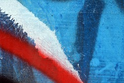 Wall painted blue red white black paint. Macro photo