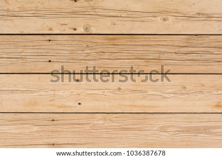 wall pattern of wooden boards with screws