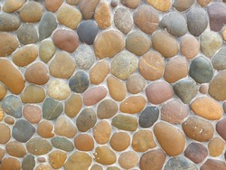 Wall round stone rock texture and seamless background.